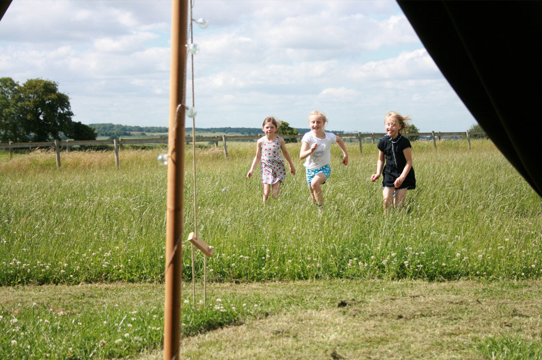 Children running to Bell Tent